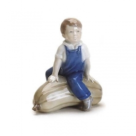 Royal Copenhagen ceramic baby with pumpkin 12cm Figurines 1021153